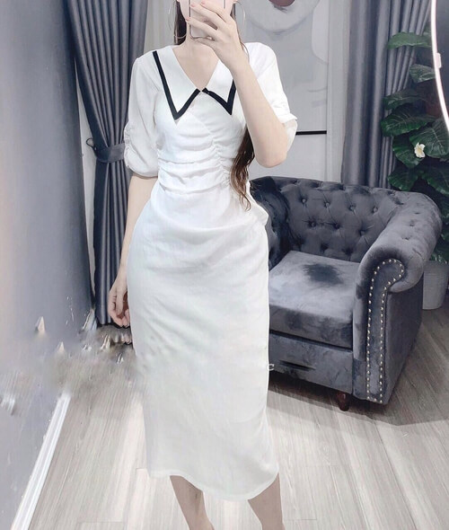 Đầm trắng dài viền cổ xéo nhọn